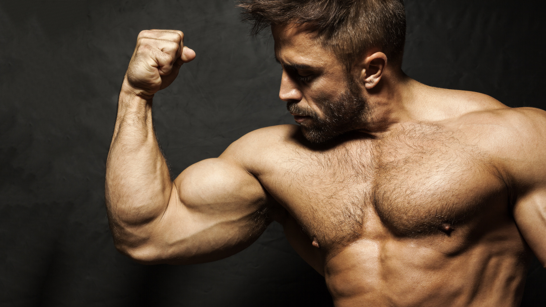 A muscular man flexing his biceps